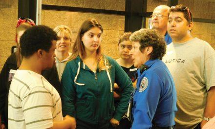 TSA officials coach PEP members on pre-flight screening