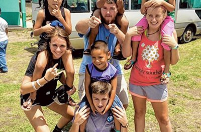 Local 'volun-tourists' take service trips to lend a hand