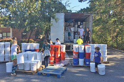 In wake of storm, volunteers pull together to begin recovery