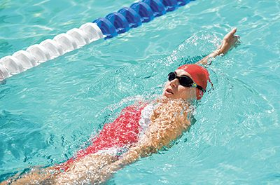 Practice single-arm swimming to improve stroke efficiency