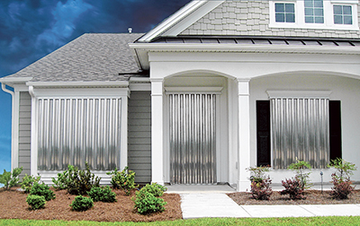 Protect home from storm damage with shutters