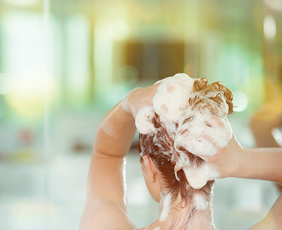 Shampoo in moderation, but style your hair daily