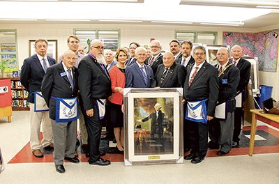 Masons donate Washington portraits to all local public schools