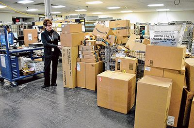 Excitement, growth challenges ahead for new postmaster