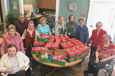 Elder helpers pack gifts for children around the world