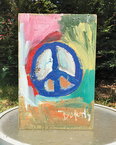 Visiting painter practices  random acts of art on tour