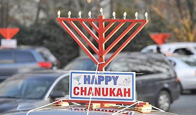 Inaugural Hanukkah event features parade, 9-foot menorah