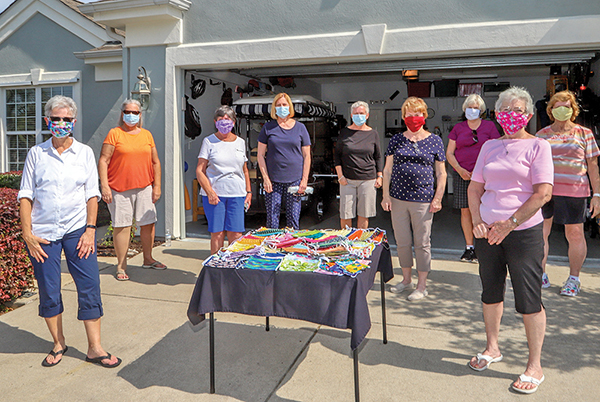 Quilting friends create masks separately but together