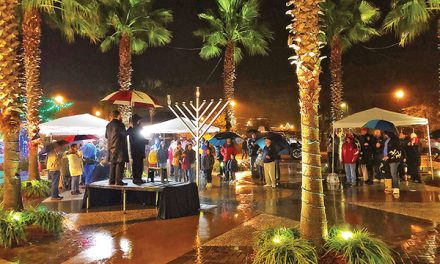 Hanukkah parade, menorah lighting part of global event