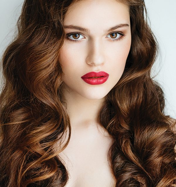 Solve end-of-summer frizz issues with smoothing treatments